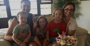 Brad, Rebecca and children Quincy, Ava and Fin celebrating a birthday.